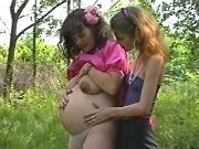 Pregnant lesbian has fun with girlfriend in forest