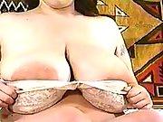 Cutie milks own enormous tits