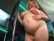 Fat blonde whore dances strip-tease