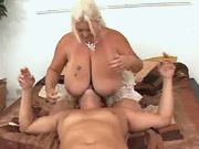 Plump old lady plays with huge tits for young guy