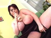 Brunette fatty dildofucks on sofa