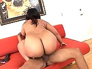 Horny black fatty rides dark cock on sofa