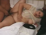 Portly busty honey sucks on the bed