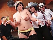 The horny fat chicks strip and tease before one BBW bends over to be double teamed