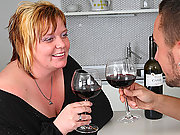 A glass of wine gets things lubed up and then her BBW pussy is taken by his hard cock